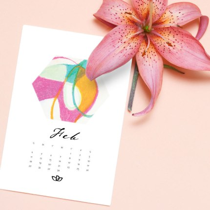 An elegant flower lily of delicate hues and a white leaf bumigi for writing lies on a light pink background.